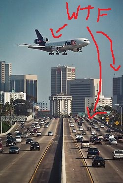 this plane is way too close to the freeway and the buildings